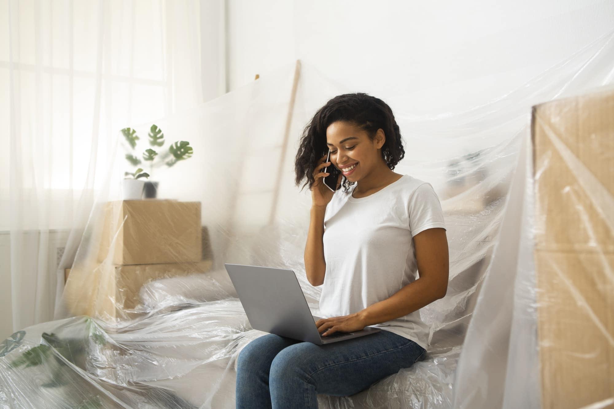 Girl looking workers to repair by phone